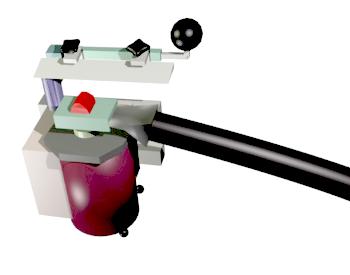 Microtomo de congelación. El tubo negro de la derecha es el encargado de enfriar el portabloques a temperaturas inferiores a -20 °C, lo cual congela a su vez a la muestra (color rojo). Las secciones se recogen de la cuchilla con un pincel y se colocan en tampón de trabajo.